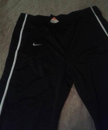 spodnie Nike dresowe rozpinane po bokach Nowy produkt